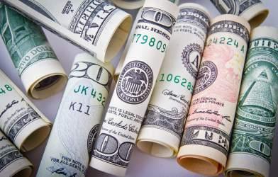 Rolled up money, dollar bills