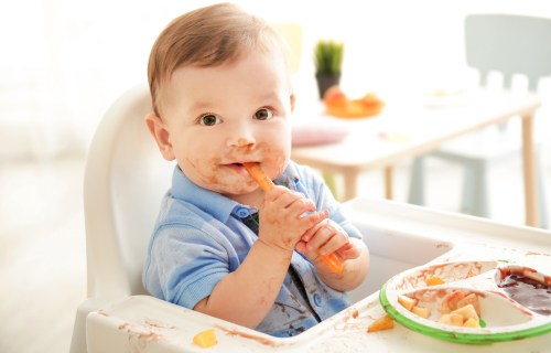 Messy baby eating