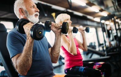 Older adults working out at gym