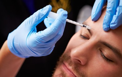 Man having Botox injection, cosmetic procedure
