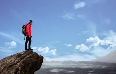 Man traveling alone atop mountain