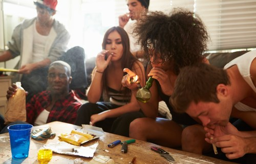 Group Of Young People Taking Drugs, Doing Cocaine, Marijuana