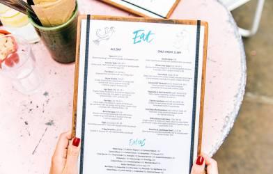 Person holding menu in restaurant
