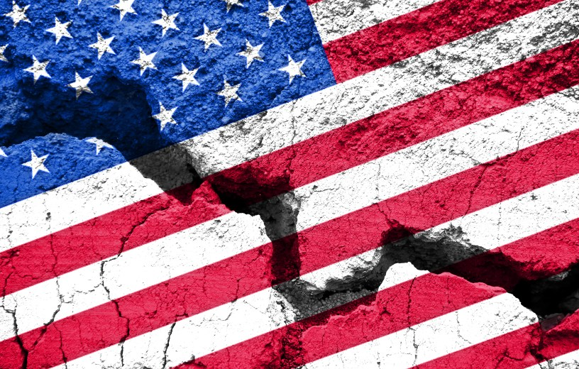 Cracked, split American flag indicates divided country