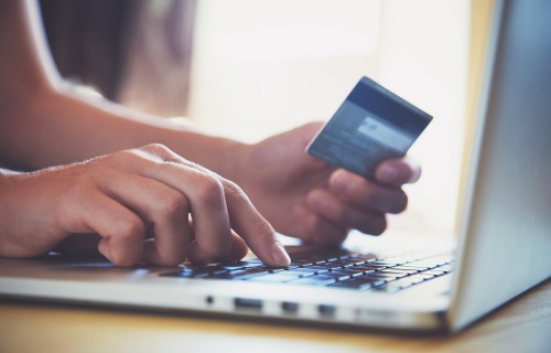 Person online shopping with credit card