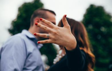 Woman showing off engagement ring after proposal