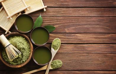 Green tea in bowls, spoons