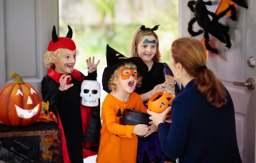 Trick or treaters getting Halloween candy