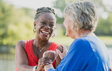 Older women, friends laughing