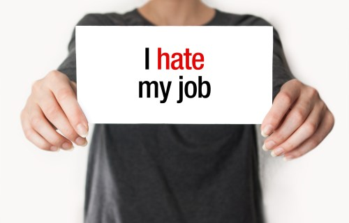 """Woman holding """"I Hate My Job"""" sign"""
