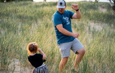 Father dancing with little girl