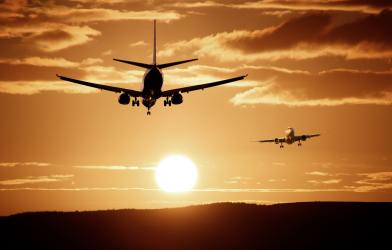 Commercial airplanes in sunset