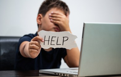 Boy being cyberbullied or experiencing digital dating abuse