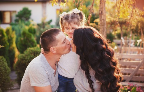 Parents kissing in front of child