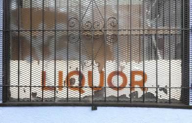 Liquor store sign in window