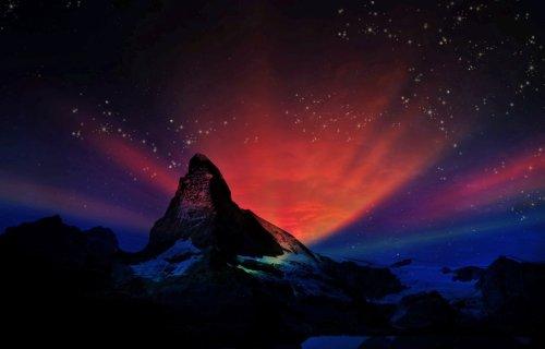 Red aurora in sky