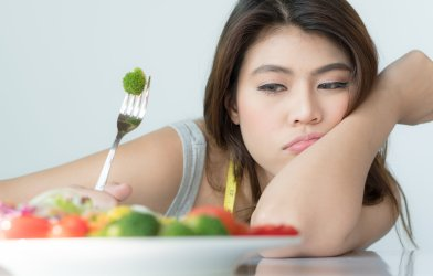 Woman doesn't want to eat vegetables or salad