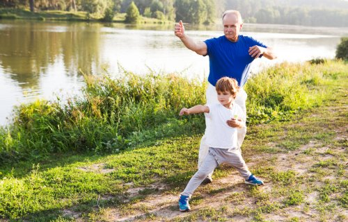 Boy practicing Tai Chi with grandfather