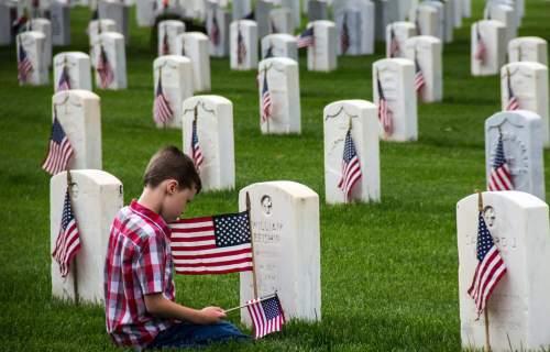 Boy at Veterans Cemetery on Memorial Day