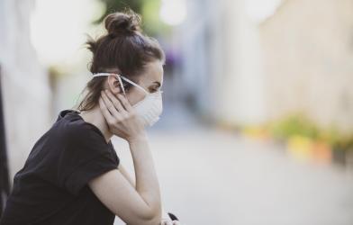 Woman wearing N95 mask during coronavirus outbreak
