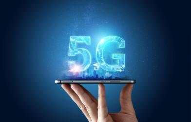5G network hologram above smartphone