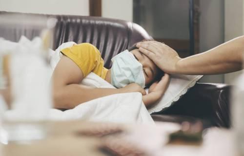 Sick child wearing mask, possible coronavirus / COVID-19 infection