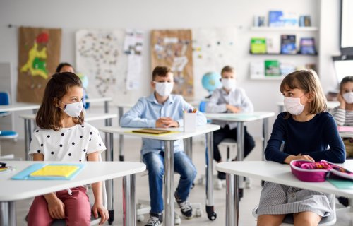 Children wearing masks in school during coronavirus / COVID-19 outbreak