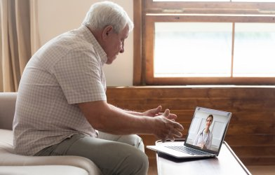 Telehealth for seniors: Older man on a virtual doctor's visit