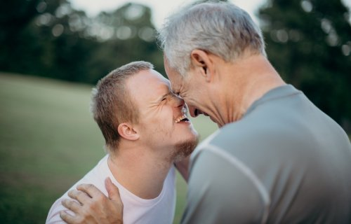 Father with son who has Down syndrome