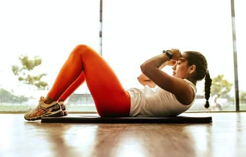 Woman exercising, doing sit-ups