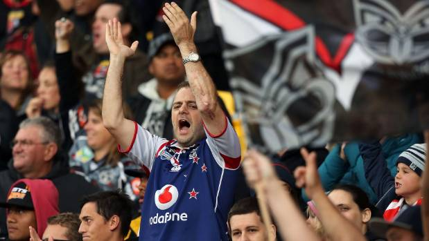 FULL VOICE: A Warriors fan shows support for his team during last season's clash with Wests Tigers at Westpac stadium.