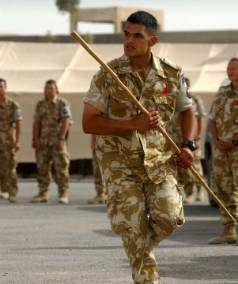 A DECADE AGO: Prime Minister Helen Clark visited Kiwi troops serving on Operation Telic II in Basra, Iraq in November 2003. Whangarei soldier Sapper Aaron Butler greeted the PM with the Wero.