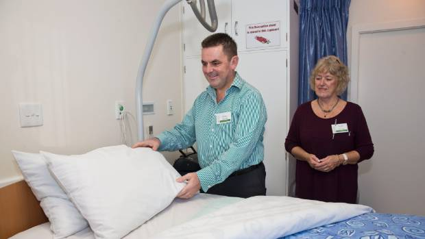 Nelson Marlborough District Health Board CEO Chris Fleming volunteering, left with the help of volunteer Averill Moore at the Nelson Tasman Hospice as part of the Volunteer Challenge.