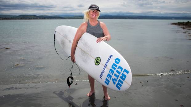 Surfer Marguerite Vujcich says she is happy to take up the challenge of encouraging more women to compete at the sport's national champs.