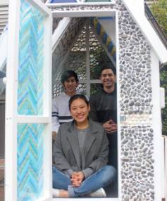 Architecture students Leo Nishimura, Dorien Viliamu and Rosemary Li, front, sit in one of the four playhouses.