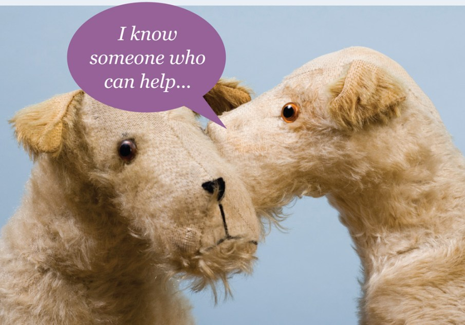 One stuffed dog whispering to another: 'There's someone who can help'