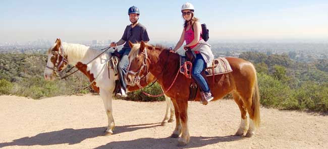 David Rodriguez and Nila on horses