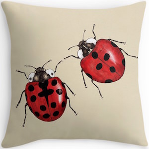 Two Ladybugs On A Pillow
