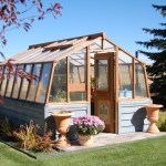 Barn-shaped wood greenhouse photos