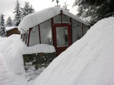 Insulation is important with snow loads such as these. The greenhouse structure must also be able to support snow loads.
