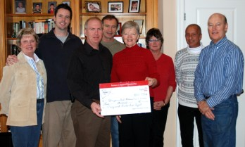 The Sturgeon Point Association's Lynne Manning accepts a $5000 cheque from Jack Steele of Hydro One.