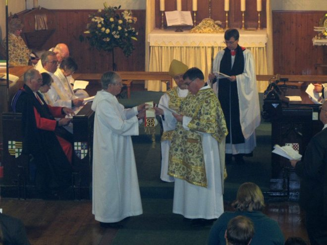 The Sacristan, Christopher Hartley, presents a stole to Canon Allan Maclean at his Institution to St Vincent's on St Vincent's Day, 22 January 2015
