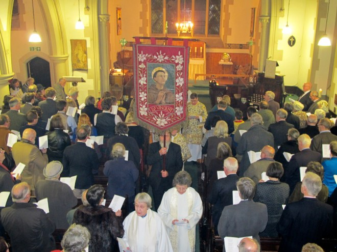 The banner of St Vincent precedes the clergy following the Institution by the Bishop of Edinburgh of Canon Allan Maclean as Rector of St Vincent's on St Vincent's Day, 22 January 2015