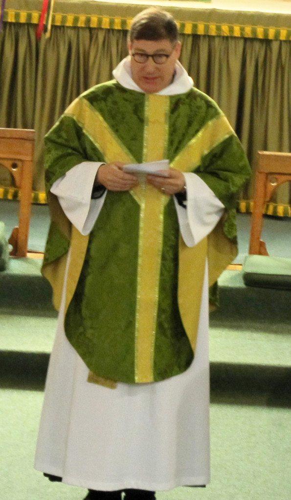 Canon Allan Maclean, Rector, welcomes the congregation.