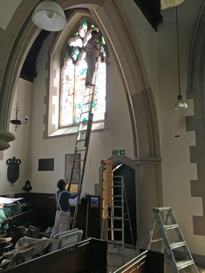 Decorators repairing storm damage in July 2016.