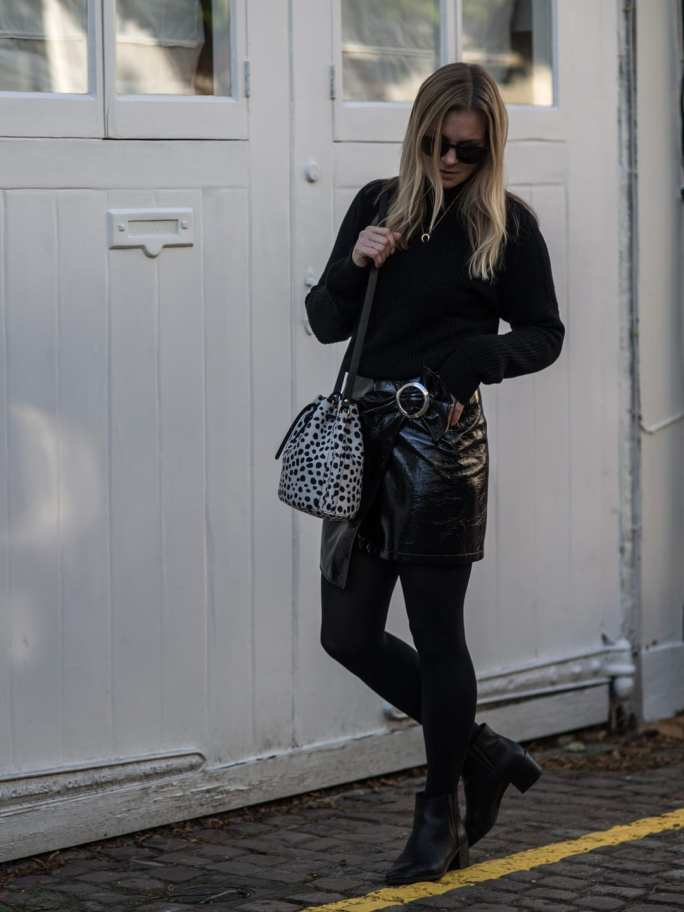 All Black | AV Black Sweater, Mango Patent Skirt, Seven Boot Lane Black Ankle Boots, Baia Leopard Print Bucket Bag