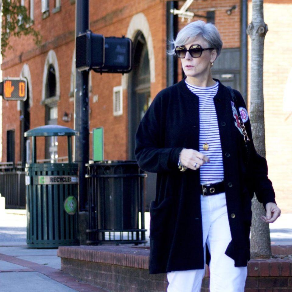 black cardigan, white denim, black mules