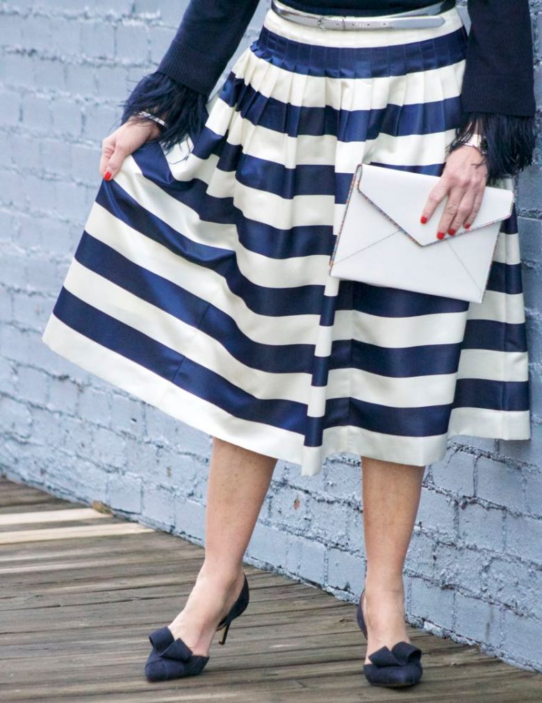 j.crew feather sleeve crewneck sweater, j.crew pleated satin stripe skirt, nine west suede pumps, rebecca minkoff leo envelope clutch