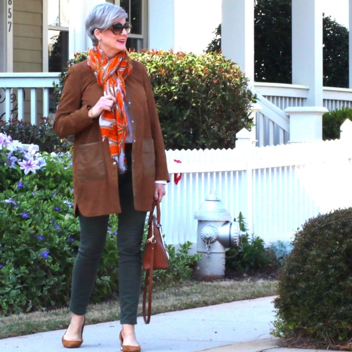 shifting into neutral with suede duster, white shirt, and green cargo pants