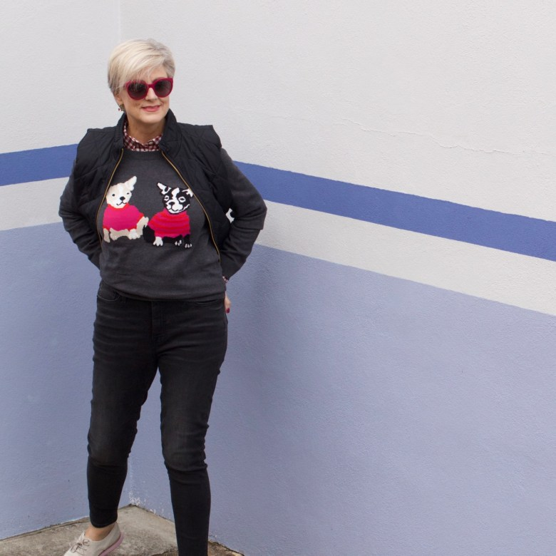 beth from Style at a Certain Age wears a J.Crew Factory high rise skinny jean, burgundy check shirt, french bulldog teddie sweater, quilted puffer jacket